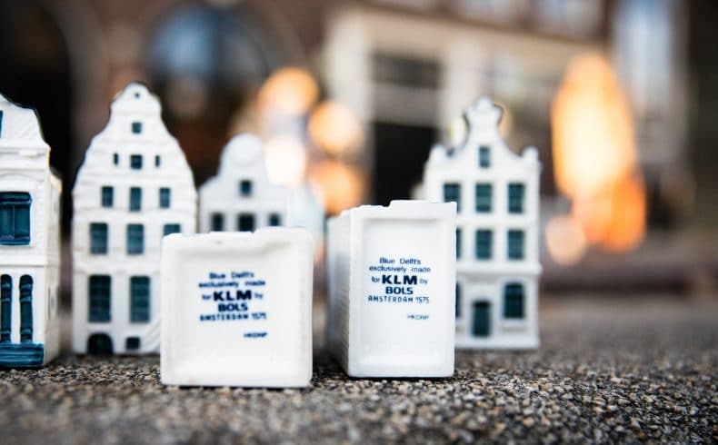 Iconic KLM Delft Blue miniature houses in Amsterdam filled with jenever